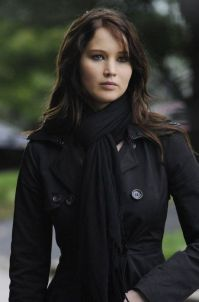 First Lady Katniss Everdeen at a campaign event for her husband, President Peeta Mellark, in District 14. Everdeen is a former war hero, president, and Secretary-General of the Council of Nations.